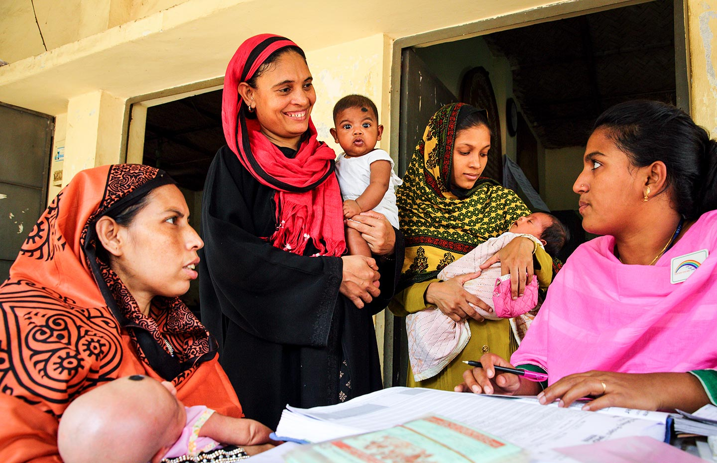 Gavi/2015/GMB Akash – Parents attend the vaccine session at the EPI centre in Dhaka, Bangladesh
