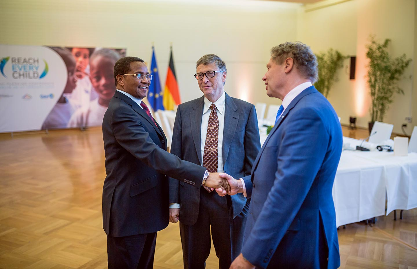 (L-R) Bill Gates, co-chair of the Bill & Melinda Gates Foundation, looks on as Global Ambassador for immunisation and former President of Tanzania Jakaya Kikwete (L) shakes hands with Gavi CEO Seth Berkley. Credit: Gavi/BMZ/2015/Stefan Zeits