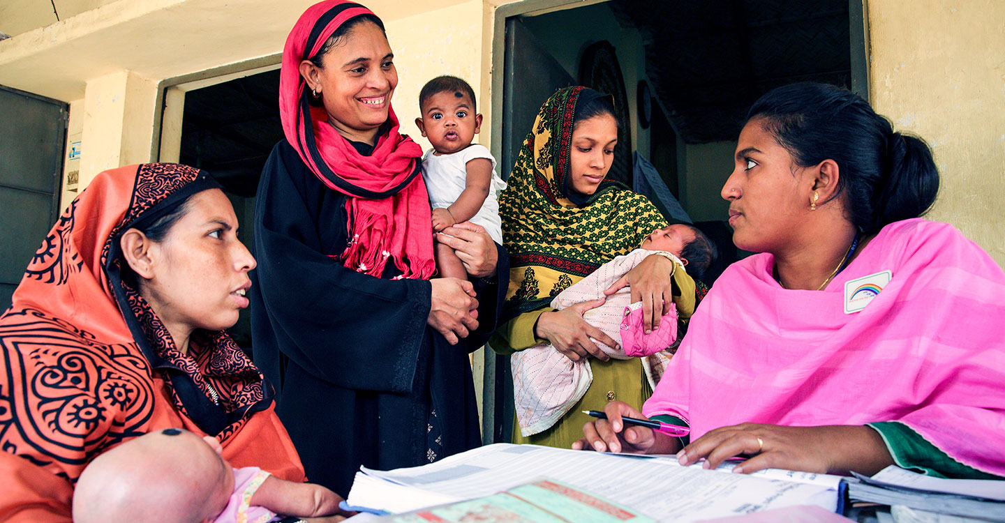 Gavi/GMB Akash- Parents attend the vaccine session at the EPI centre in Dhaka, Bangladesh