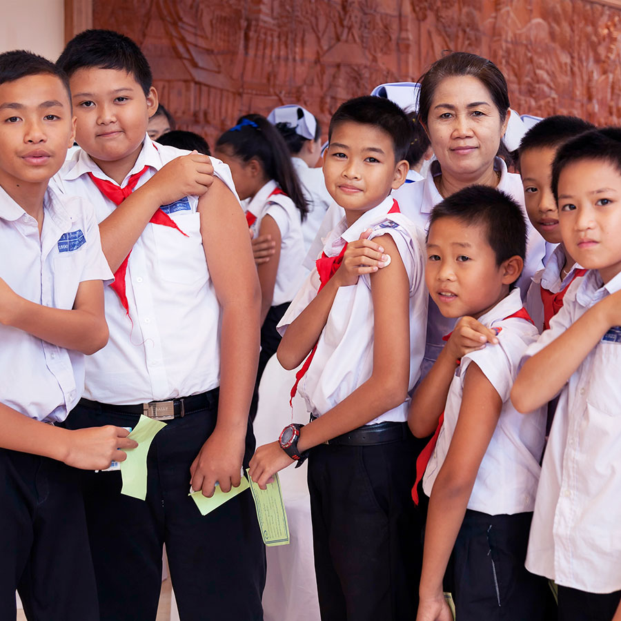 Students in Vientiane, Lao People's Democratic Republic (PDR), after receiving their first dose of Japanese encephalitis (JE) vaccine. In 2015, Lao PDR became the first country to use support from Gavi to protect its children from JE. Credit: Bart Verweij