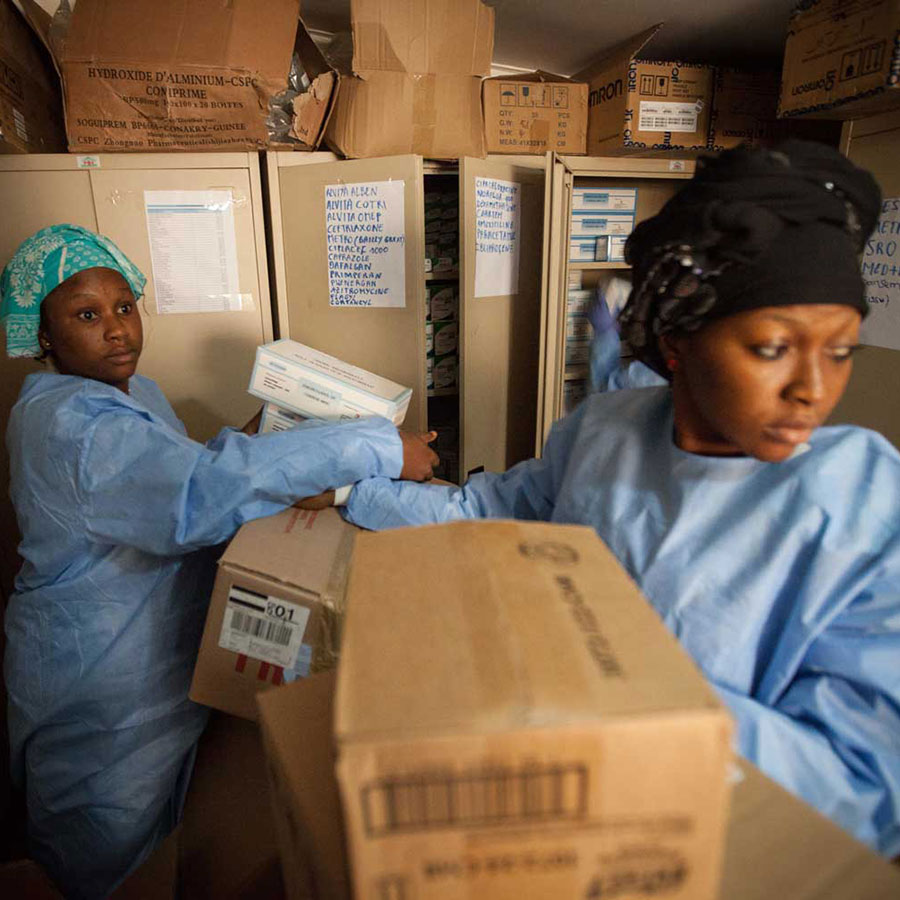 WHO staff prepare pharmaceuticals for the participants in the clinical trials of the Ebola vaccine in Guinea. Photo: WHO/2015/Sean Hawkey