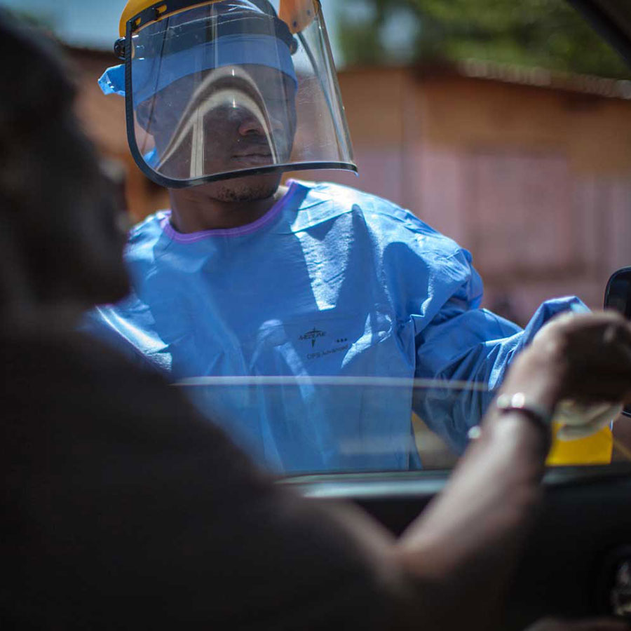 Routine checks in Guinea during period of Ebola virus. Photo: WHO/2015/Sean Hawkey
