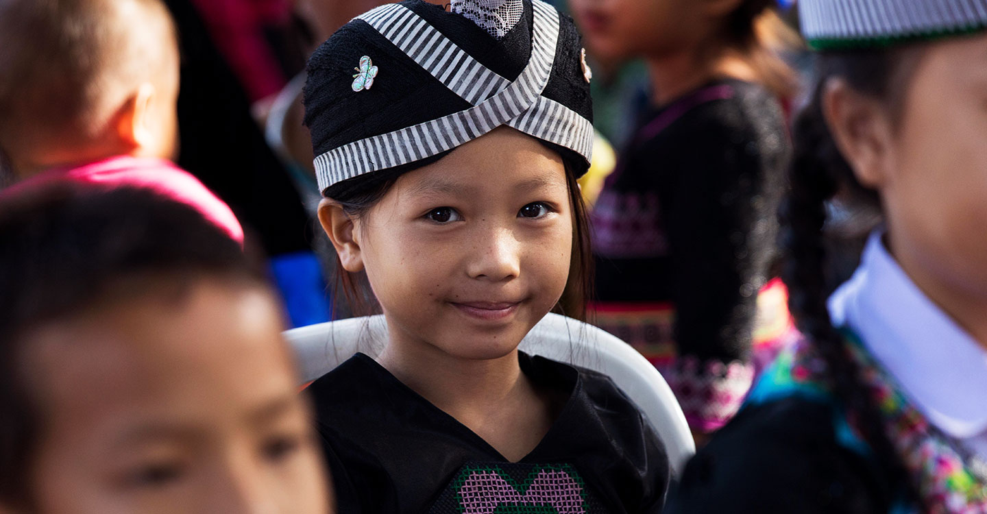 A girl in a crowd in Laos during a Gavi Board visit