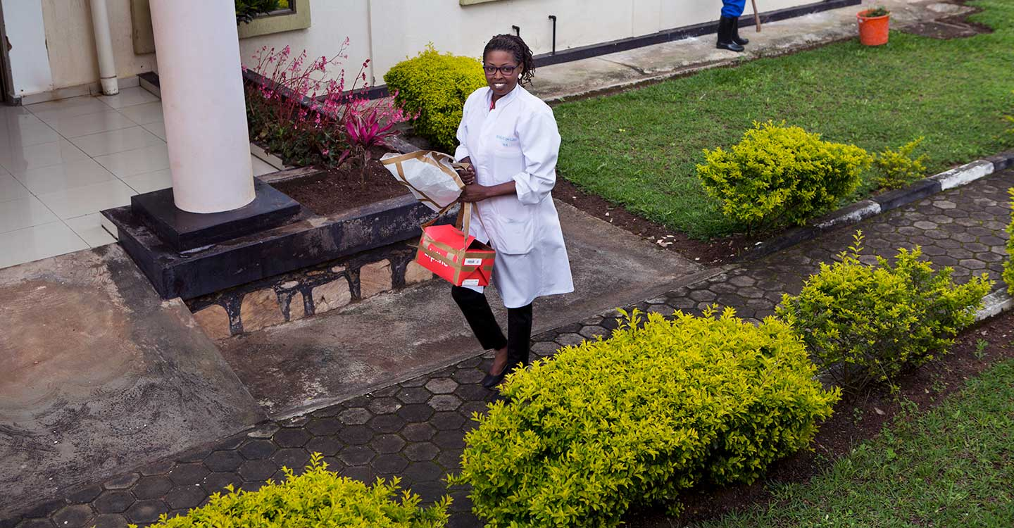 Nurse Umwamariya Alice collects a Zipline delivery. Credit: Karel Prinsloo/Gavi/Arete