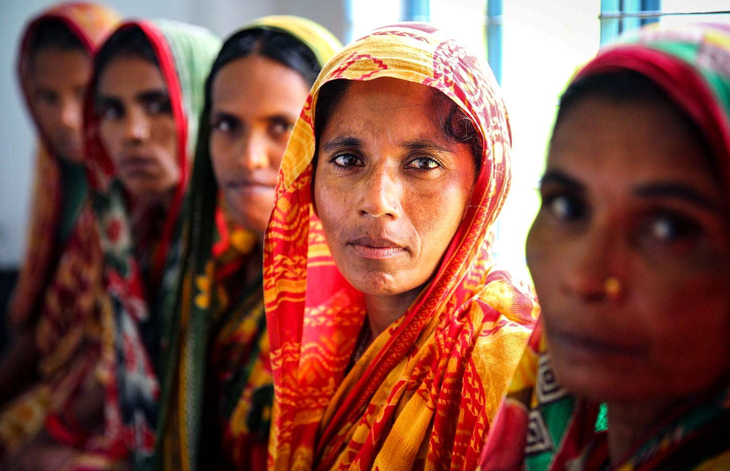 Gavi/2014/GMB Akash/Bangladesh- Women come to the community clinic for taking treatment. Char kanto Nagar community clinic is a newly built community clinic in tekani Island in the north of Bangladesh. Most of the women of the community and all of the pregnant women are dependent on this clinic now. Char kanto Nagar,Kazipur, bangladesh