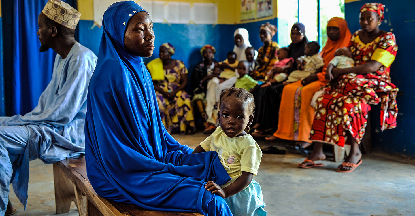 Mother and daughter waiting in a hospital in Nigeria
