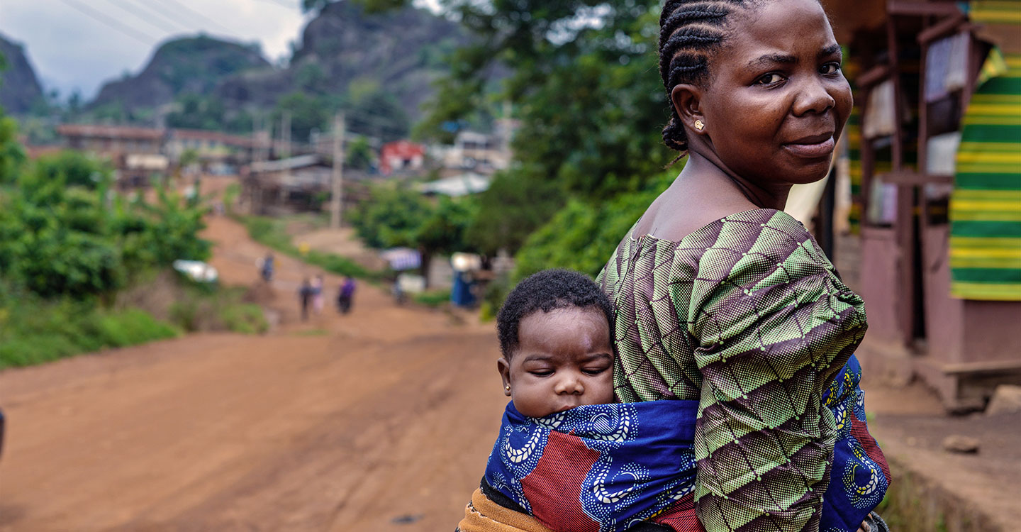 Mother with baby on her back in Nigeria