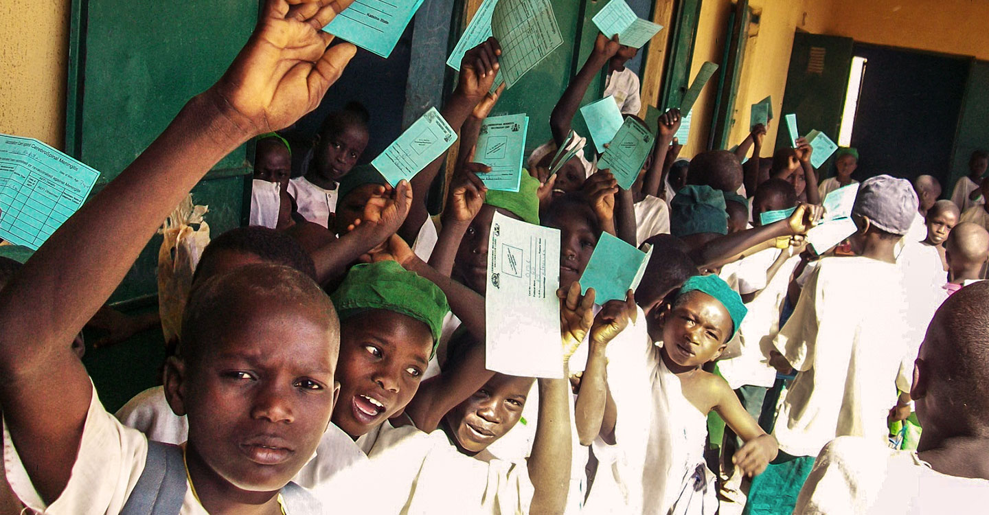School children holding immunisation cards in Nigeria. It is one of 21 countries that have launched meningitis A campaigns with support from Gavi.   Credit: Gavi/2011/Ed Harris