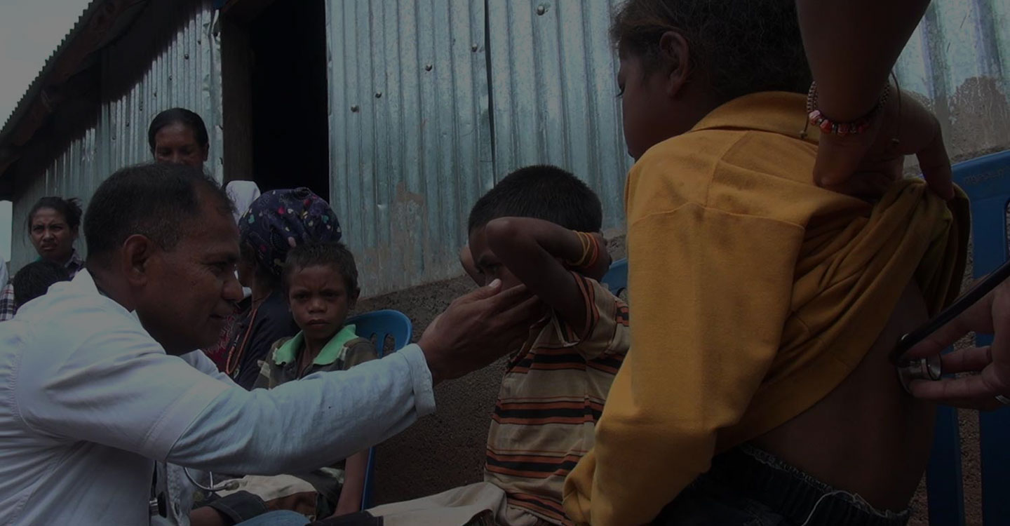 doctor inspecting a child in tl village