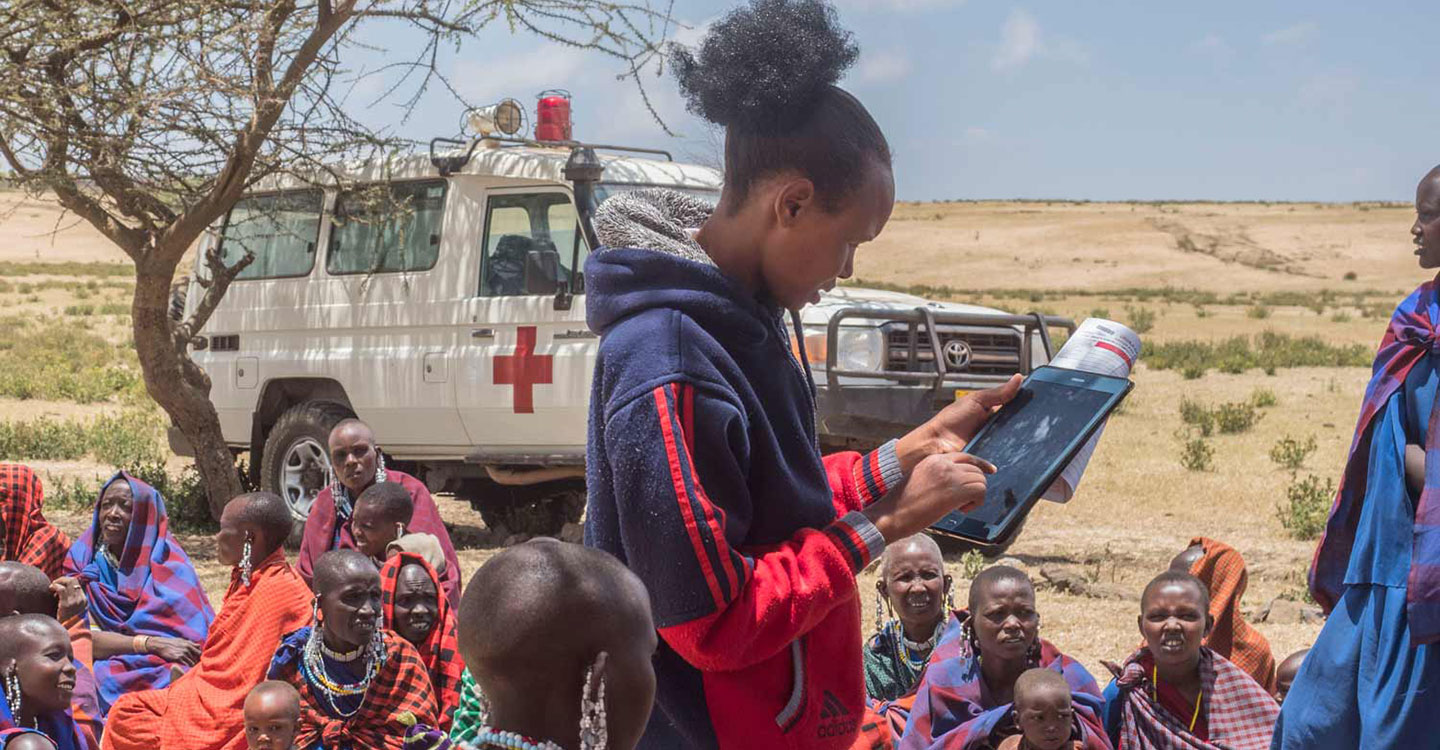 Tablet displays medical records of mothers their children. Photo credit: Gavi/2018/Hervé Lequeux.