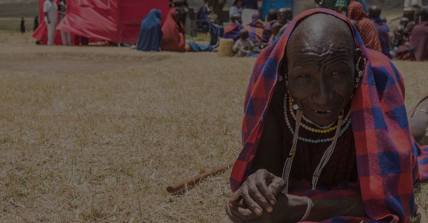 smiling maasai laying in the grass