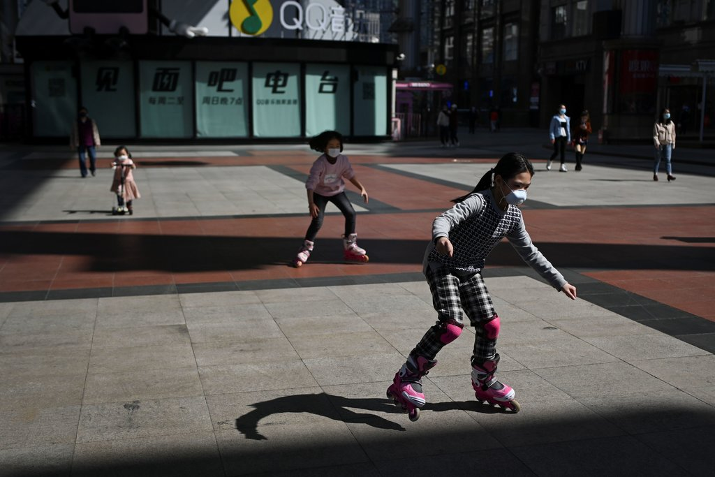 Image from NYTimes article – Children played outside a mall in Beijing on Tuesday. Credit...Wang Zhao/Agence France-Presse — Getty Images