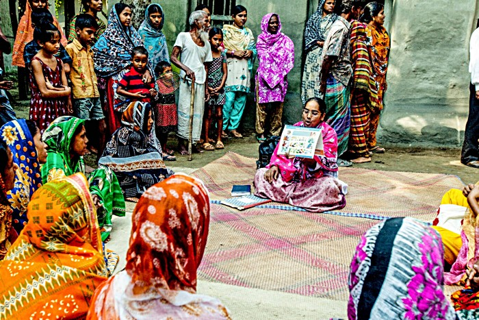 A healthcare worker in Bangladesh educates parents from a rural area about the importance of immunisation. A critical part of the success of immunisation campaigns is generating demand – engaging with communities to ensure parents trust the safety and efficacy of vaccines and are motivated to make sure their children complete recommended immunisation schedules on time.
