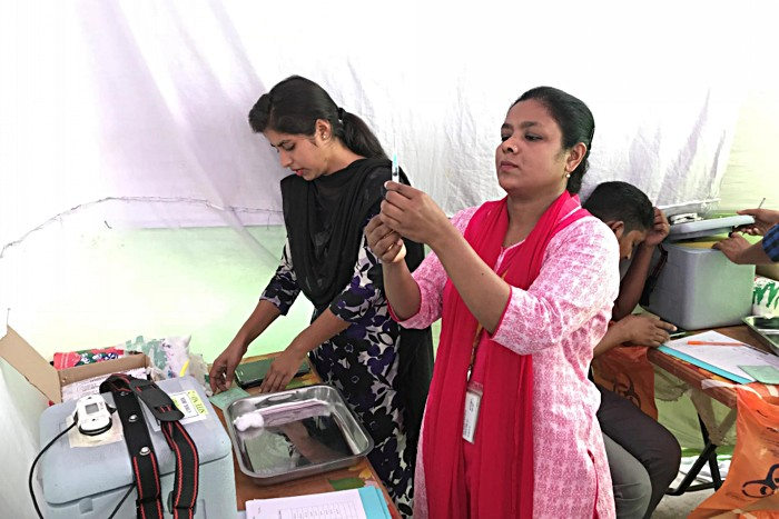 Healthcare workers get ready to deliver the typhoid conjugate vaccine (TCV) during a 2018 clinical trial in Bangladesh. A significant portion of typhoid cases occur in children under 5, and the new conjugate vaccine can be administered to children as young as 6 months old while providing longer-lasting immunity than previous vaccines. Expanding coverage will not only save lives and decrease the burden of the disease: the WHO recommends the typhoid vaccine as an important step to help low- and middle-income
