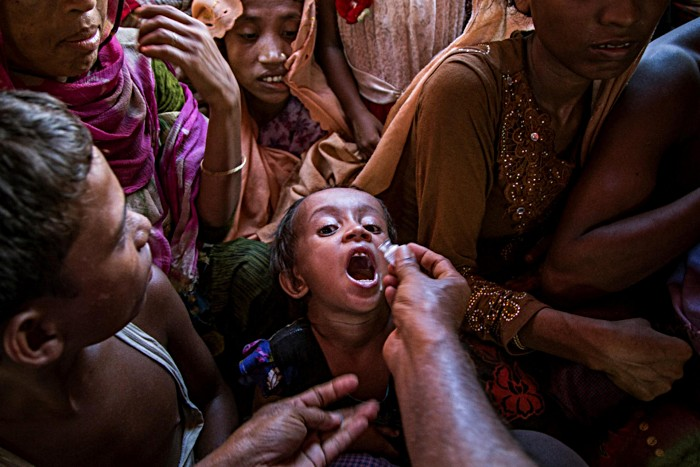 A Rohingya child receives the oral cholera vaccine at Shafullarkata refugee camp in Cox's Bazar, Bangladesh. In 2017, Gavi funded one of the largest cholera vaccination campaigns in history to protect nearly a million people against the disease in camps and surrounding areas. Working on the principle that no child should be denied the right to good health, including access to life-saving vaccines, the Alliance continues to support routine immunisation at the camps.
