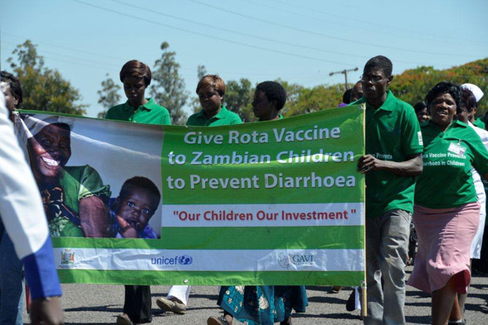 Health workers march proudly to first vaccination ceremony with a banner reinforcing the key public health message that rotavirus vaccines are a critical part of a comprehensive strategy to prevent diarrhoea, a leading killer of young children in Zambia.
