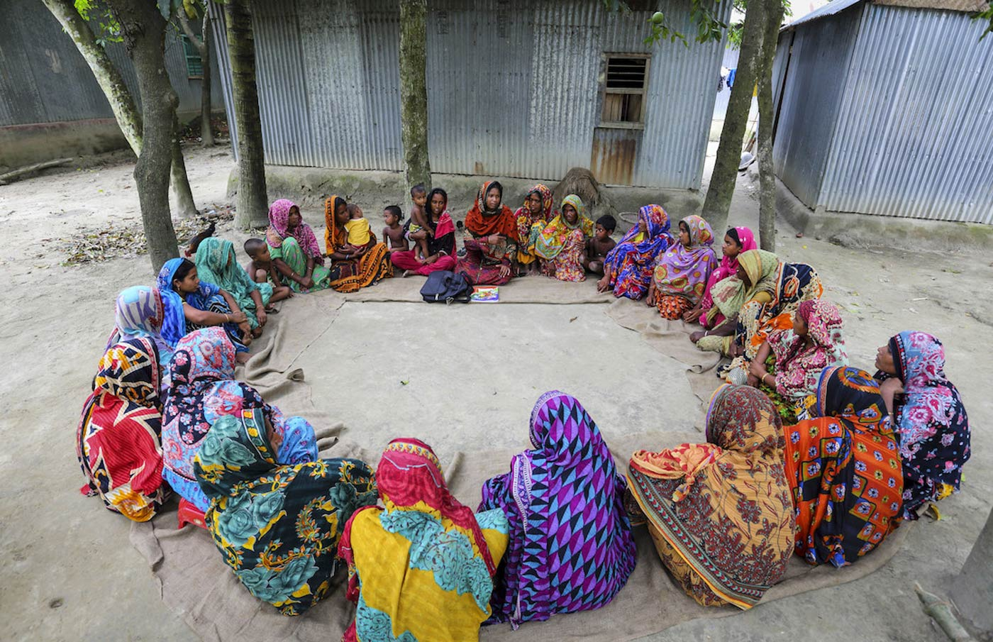 Health worker and pregnant women sitting in a circle in Bangladesh. Credit: Gavi/2014/GMB Akash.