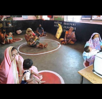Mothers observe physical distancing at a routine immunisation session in Raipur, India Credit: Anjali Ray/2020.
