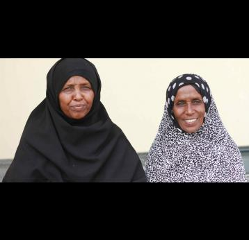 Halima Aso (left), mother of 8 and member of the Women's Federation, Berhale District, Ethiopia