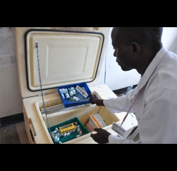 Vaccine product characteristics vary widely. Differences in volume, number of doses, and cold storage requirements—like the refrigerator shown here at Kimbiji Health Center in Tanzania – can have a big impact on cost. Photo: PATH/Doune Porter.