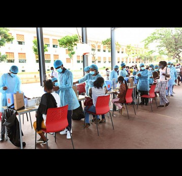 "A vaccination session gets underway at the ""Paz Flor"" Tourist Complex, Luanda' – Credit: Gaspar Micolo"