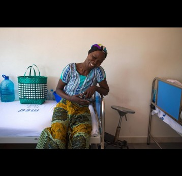 Cervical cancer patient Flora Jacobs poses with her head scarf to cover her hair loss at the Ocean Road Cancer Institute in Dar es Salaam. – Credit: Gavi/2014/Karel Prinsloo