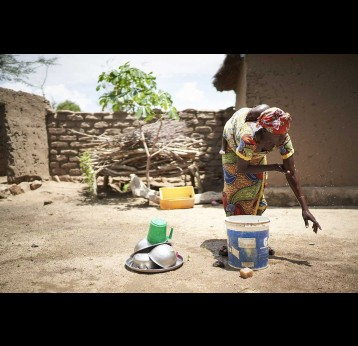 woman washing her hand at a handwashing station in front of her home in Marua – Gavi/2020/Christophe Da Silva