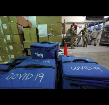 Cooler bags in the Madigan Army Medical Center at Joint Base Lewis-McChord that will be used to transport vials of the first shipment of the Pfizer vaccine for COVID-19 to other locations in the hospital. Courtesy of Ted S. Warren/Associated Press.
