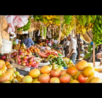 Fruit and vegetables at a market in Kenya. The WHO is pushing for consumption of fresh fruits and vegetables, whole grains, beans, fish and unsaturated fats. Shutterstock