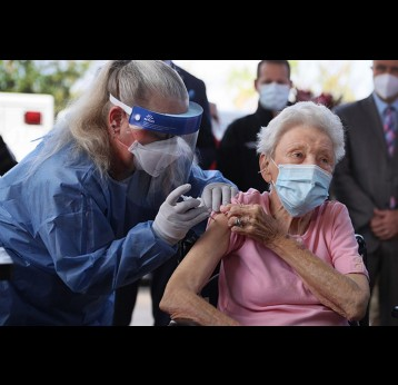 Elderly woman getting a vaccine, photo credit, Joe Raedle