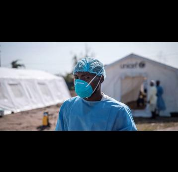 A health worker in protective clothing