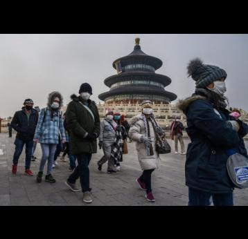 Visitors to the Temple of Heaven, Beijing. Credit: Kevin Frayer Getty Images.