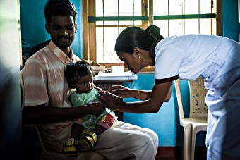 UNF Sri Lanka vaccination - father with child