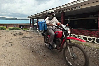 A health worker delivers the human papillomavirus (HPV) vaccine to a rural school in Rwanda