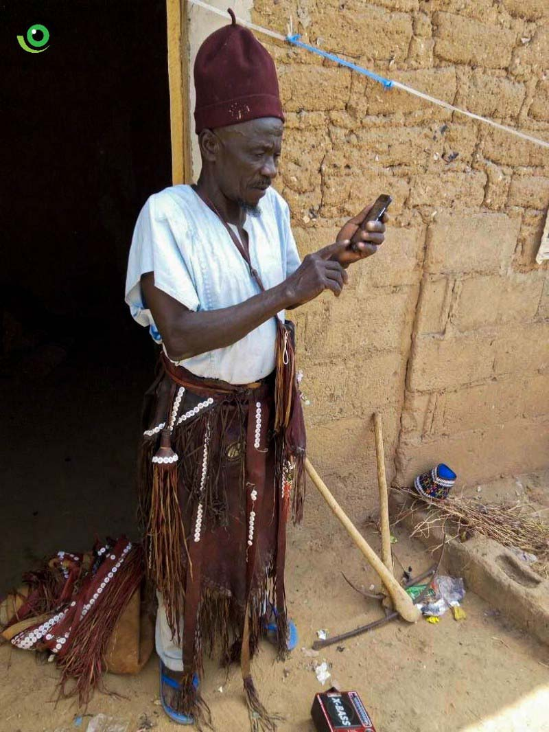 A local traditional healer, who doubles as AVADAR community volunteer in action searching for GPS coordinates as part of the App walkthrough: Photo credit: Nigeria Health Watch