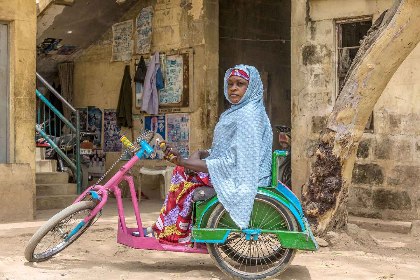 "Paralysed as a child by polio, Mariam Umar from Kano State has been working as a community mobilizer with the polio eradication programme for seven years. ""I help mobilize people, so my community would accept the vaccine when they see my situation."" © Andrew Esiebo/WHO"