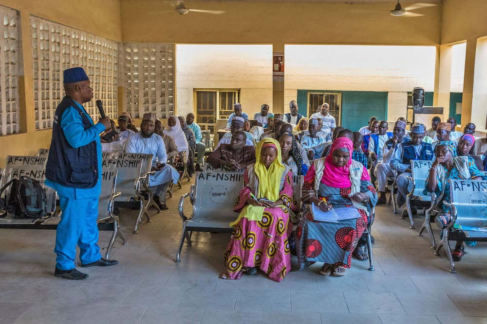 A local government council meeting with traditional leaders in Maiduguri, Borno State discusses the impact of recent immunization campaigns. © Andrew Esiebo/WHO