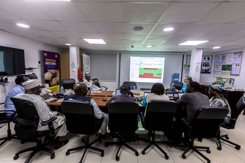 In Borno State's Emergency Operations Centre (EOC), polio teams deliberate on vaccine campaign performance. © Andrew Esiebo/WHO