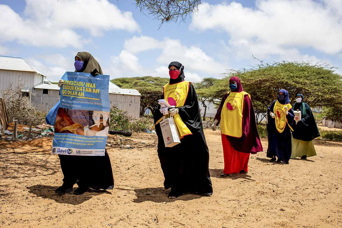 Health workers walk to at Kahda district as they wait for children to vaccinations as part of national polio and measles vaccination campaign in Mogadishu, Somalia on Tuesday 01 September 2020. Photo Ismail Taxta / Ildoog/WHO SOMALIA