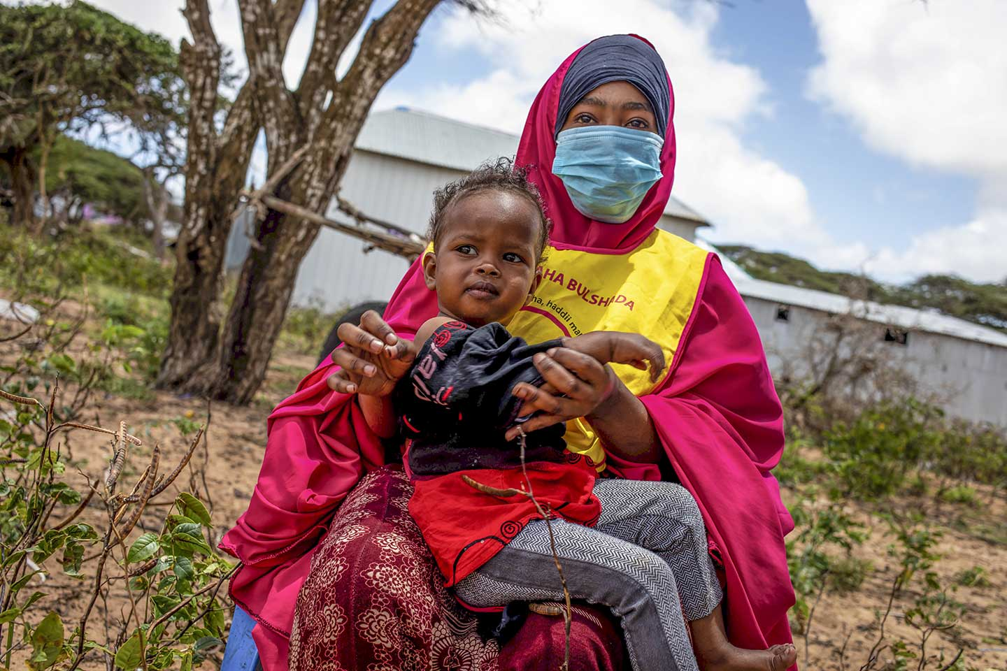 A young girl waits to be vaccinated during national polio and measles vaccination campaign in Mogadishu, Somalia on Tuesday 01 September 2020. Photo Ismail Taxta / Ildoog/WHO SOMALIA
