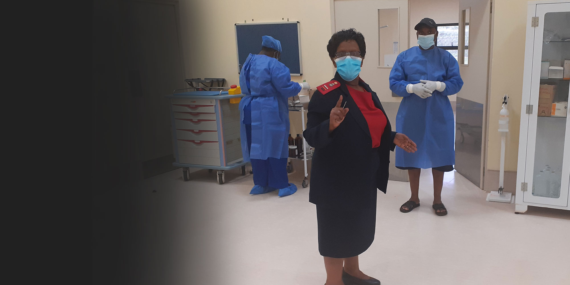 Matron Nurse Sibongile Simelane inspecting the emergency ward and staff prior to the arrival of a COVID-19 patient. Credit: Nonduduzo Kunene