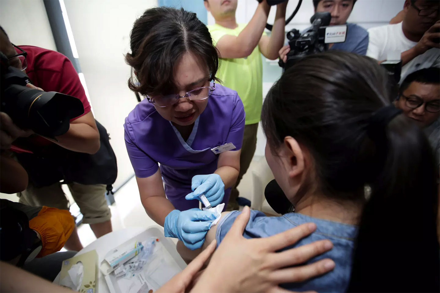 Woman in China receiving the HPV vaccine. Image: REUTERS/Stringer.