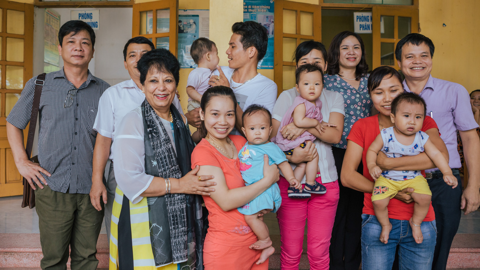 The author with parents at the community clinic. Photo: Gavi 2017/ Đạt Nguyễn.